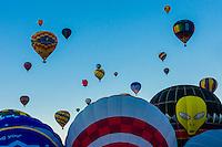 Hot air balloons lifting off, Balloon Fiesta Park, Albuquerque International Balloon Fiesta, Albuquerque, New Mexico USA.