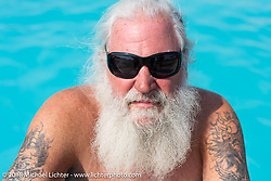 Pat Ford in the Full Throttle Saloon swimming pool during the 78th annual Sturgis Motorcycle Rally. Sturgis, SD. USA. Thursday August 9, 2018. Photography ©2018 Michael Lichter.