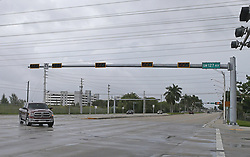 Cars driving by a traffic light at 88th Street and 137th Avenue in Miami as the outer bands of Hurricane Irma reach South Florida early on Saturday, September 9, 2017. Photo by David Santiago/El Nuevo Herald/TNS/ABACAPRESS.COM