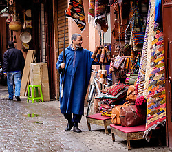 A shopkeeper open up his shop in the early morning in the medina in Marrakech, Morocco, North Africa<br /> <br /> (c) Andrew Wilson   Edinburgh Elite media