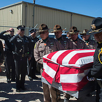 Officers from the Navajo Nation Police Department and the McKinley County Sheriff's Department carry the casket of fallen Navajo Nation Police Officer Houston Largo to his final resting place in Sunset Memorial Park in Gallup Thursday March 16. Officer Largo was killed responding to a domestic violence call early Sunday morning.