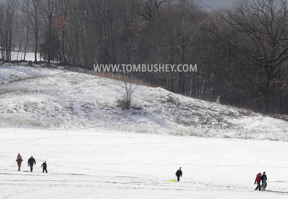 Salisbury Mills, Nwew York - People walk across a field after sledding on Jan. 2, 2010.