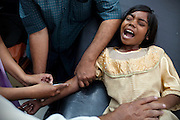 Poonam's older sister Jyoti, 11, is being picked with a needle to extract and check her blood's levels, during a standard health check in Bhopal, central India, near the abandoned Union Carbide (now DOW Chemical) industrial complex, site of the infamous '1984 Gas Disaster'. Jyoti's blood levels and quality resulted devoid of any problem.