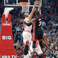 14 March 2012: Miami Heat shooting guard Dwyane Wade (3) goes for the floater over Chicago Bulls power forward Carlos Boozer (5) during the Chicago Bulls 106-102 victory over the Miami Heat at the United Center, Chicago, Illinois, USA.