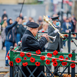 As old and new generations come together to remember their own paying respect in Swindon today for remembrance Sunday. A somber moment paying respect for their loved ones and for those for us to remember them. Swindon Wiltshire 08/11/2020