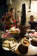 A Beijing hot pot meal served at an outdoor restaurant located in a hutong in Beijing, China.