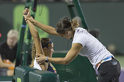 March 26, 2018 - Miami, FL, United States - KEY BISCAYNE, FL - March, 26:Monica Puig (PUR) receives medical treatment during her match against Danielle Collins (USA) at the 2018 Miami Open on March 24, 2018, at the Tennis Center at Crandon Park in Key Biscayne, FL. (Credit Image: © Andrew Patron via ZUMA Wire)