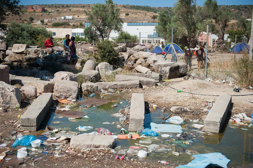 Brackish water full of rubbish in Kara Tepe camp.
