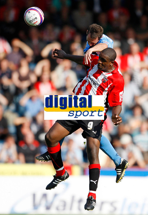 Photo: Richard Lane/Richard Lane Photography. Wycombe Wanderers v Brentford. Coca Cola Fotball League Two. Brentford's Nathan Elder is challenged by Wycombe's Robbie Rice.