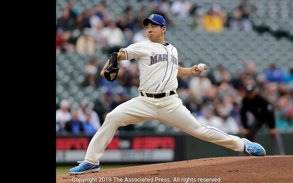 Seattle Mariners starting pitcher Yusei Kikuchi works against the Baltimore Orioles during the first inning of a baseball game, Sunday, June 23, 2019, in Seattle. (AP Photo/John Froschauer)