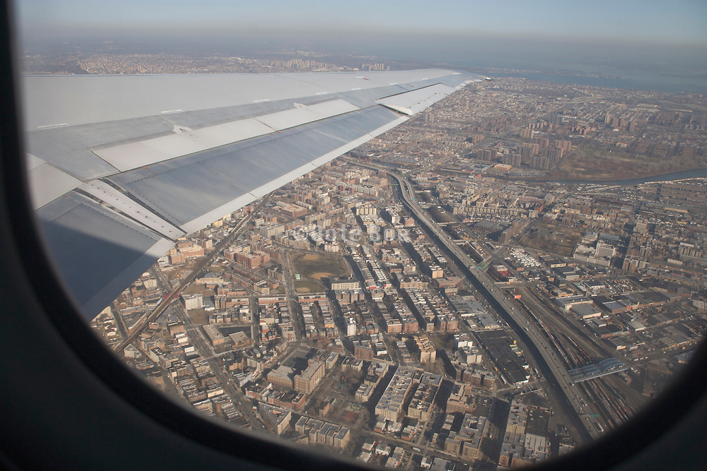 from with in an airplane going up while being above an urban area