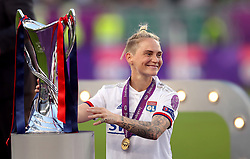 Lyon Women's Jessica Fishlock celebrates with the trophy after the match