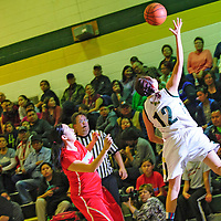 021513  Adron Gardner<br /> <br /> Thoreau Hawk Tia Tolth (12), right, tosses the ball over her head to save it from out of bounds at Thoreau High School Friday.