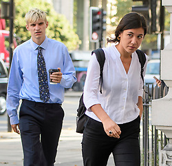 © London News Pictures. 14/09/2016. London, UK. BEN TIPPET (left) and NATALIE FINNES, cousin of actors Ralph Fiennes arrive at Westminster Magistrates Court in London where they are two of nine Black Lives Matter campaigners who face charges relating to a protest at London City Airport on September 6, in which the protest group locked themselves together on the airport's runway.  Photo credit: Ben Cawthra/LNP