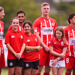 BRISBANE, AUSTRALIA - MARCH 4: Olympic FC juniors enter the field with players during the NPL Queensland Senior Mens Round 5 match between Olympic FC and SWQ Thunder at Goodwin Park on March 4, 2017 in Brisbane, Australia. (Photo by Patrick Kearney/Olympic FC)