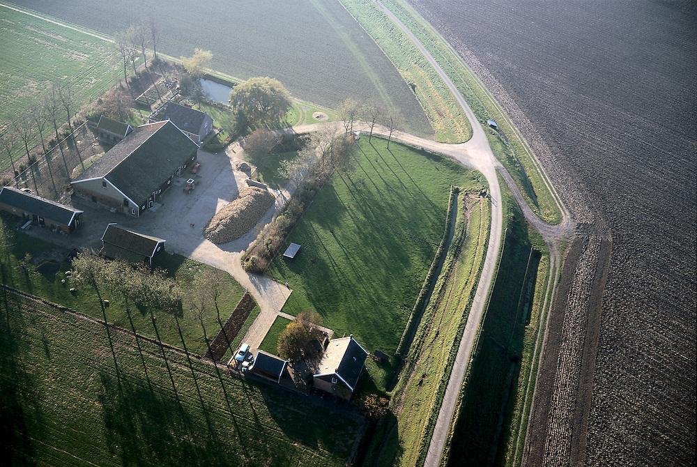 Nederland, Zeeland, Noord-Beveland, 15/11/2001; boerderij met stallen, op het erf suikerbieten, rechts akker met geploegde voren, windsingel met populieren, voormalige zeedijk, inpoldering, polder, platteland.<br /> luchtfoto (toeslag), aerial photo (additional fee)<br /> photo/foto Siebe Swart