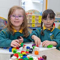 Alice Nic Carthaigh and Rhea Ní Ógáin play together on their first day of school at Gaelscoil Mhíchíl Cíosóg, Inis