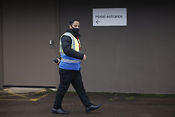 © Licensed to London News Pictures. 15/02/2021. London, UK. A security guard patrols the outside of the Radisson hotel near Heathrow Airport as the first passengers go into quarantine. People entering the UK from a 'red list' of 33 high risk countries will have to quarantine at hotels for 10 days to try and stop new coronavirus variants entering the country. Photo credit: Peter Macdiarmid/LNP