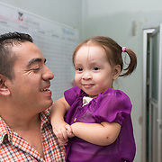 """CAPTION: Jaime recalls when Keren was born. """"Prior to this, I had never seen someone with a cleft"""", he says. """"The doctor did inform us during an ultrasound that Keren had a problem, but he assured us that it was minor and showed us the image of another child with a similar condition. When we first heard about this, there was a sense of sadness. We could not believe it, but ultimately accepted it as God's plan and His will"""". LOCATION: Hospital Escuela, Tegucigalpa, Honduras. INDIVIDUAL(S) PHOTOGRAPHED: Jaime Mijango Mejia (left) and Keren Sarahi Mijango Iriarte (right)."""