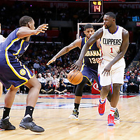02 December 2015: Los Angeles Clippers forward Lance Stephenson (1) passes the ball past Indiana Pacers forward Paul George (13) to Los Angeles Clippers forward Blake Griffin (32) during the Indiana Pacers 103-91 victory over the Los Angeles Clippers, at the Staples Center, Los Angeles, California, USA.