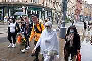 As numbers of Covid-19 cases in Birmingham have increased dramatically in recent weeks, and with the expectation that the city will be added to the watch list of critical areas which may face a local lockdown, people wearing face masks continue to come to the city centre for work and shopping on 18th August 2020 in London, United Kingdom. With other areas in the Midlands under localised lockdown, people and businesses are being urged to follow the Coronavirus advice for workplace and family life help reduce the risk.
