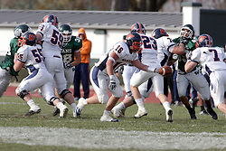 10 November 2007:  Kyle Bradley holds out the ball for Brett Jackkson. This game between the Wheaton College Thunder and the Illinois Wesleyan University Titans was for a share of the CCIW Championship and was played at Wilder Field on the campus of Illinois Wesleyan University in Bloomington Illinois.