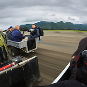 Art Wolfe traveling around Lake Clark National Park with his new Canon 1DX photographing bears.
