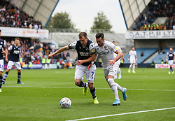 Jack Harrison of Leeds United and Jed Wallace of Millwall tussle fot he ball - Mandatory by-line: Arron Gent/JMP - 05/10/2019 - FOOTBALL - The Den - London, England - Millwall v Leeds United - Sky Bet Championship