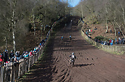Riders climbing the hill in practice.
