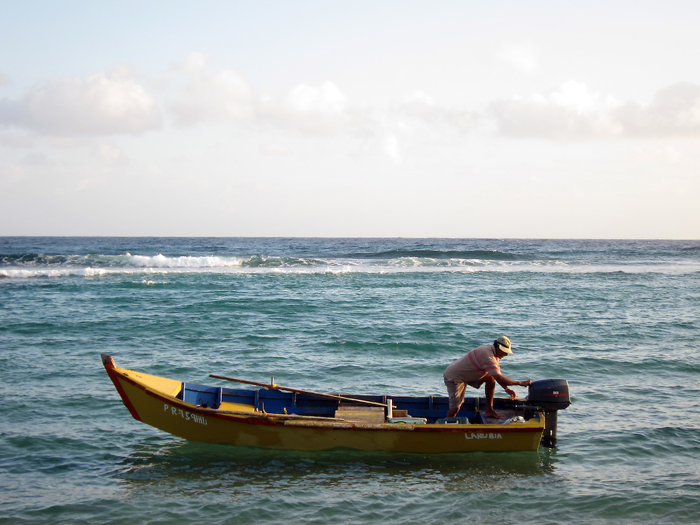 Puerto Rico Fisherman wooden boat or YOLA ready to go pick up fishing traps Jobos Beach in Isabela.