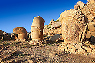 Image of the statues of around the tomb of Commagene King Antochus 1 on the top of Mount Nemrut, Turkey. Stock photos & Photo art prints. In 62 BC, King Antiochus I Theos of Commagene built on the mountain top a tomb-sanctuary flanked by huge statues (8–9 m/26–30 ft high) of himself, two lions, two eagles and various Greek, Armenian, and Iranian gods. The photos show the broken statues on the  2,134m (7,001ft)  mountain. 3 .<br /> <br /> If you prefer to buy from our ALAMY PHOTO LIBRARY  Collection visit : https://www.alamy.com/portfolio/paul-williams-funkystock/nemrutdagiancientstatues-turkey.html<br /> <br /> Visit our CLASSICAL WORLD HISTORIC SITES PHOTO COLLECTIONS for more photos to download or buy as wall art prints https://funkystock.photoshelter.com/gallery-collection/Classical-Era-Historic-Sites-Archaeological-Sites-Pictures-Images/C0000g4bSGiDL9rw