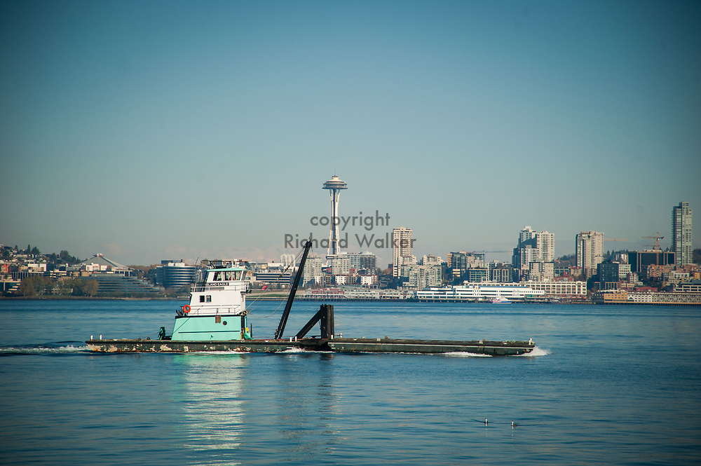 2017 NOVEMBER 06 - The boat Island Eagle sails off Alki with Space Needle in background, Seattle, WA, USA. By Richard Walker