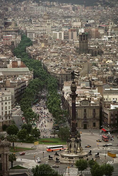 Aerial of Las Ramblas, a tree-lined street, that runs through the heart of the Gothic Quarter, starting at the port's monument to Christopher Columbus. Barcelona, Spain.