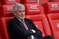 Mark Hughes, the Manager of Stoke city looks on from his seat in the dugout. Premier league match, Stoke City v Arsenal at the Bet365 Stadium in Stoke on Trent, Staffs on Saturday 13th May 2017.<br /> pic by Bradley Collyer, Andrew Orchard sports photography.