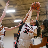 Grants Pirate Alyssa Anzures (30) tries to grab a rebound from the Gallup Bengals Friday at Grants High School.