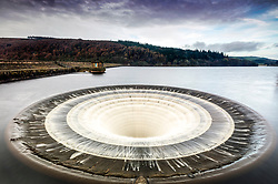 © Licensed to London News Pictures. 20/03/2019. Upper Derwent Valley UK. The West Spillway shaft known locally as the Plug Hole at Ladybower reservoir in the Upper Derwent Valley overflows this morning as the water level in the reservoir has risen due to recent rainfall. Photo credit: Andrew McCaren/LNP
