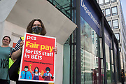 A PCS trade union rep stands on the picket line outside the Department for Business, Energy and Industrial Strategy BEIS on the second day of a 3-day strike by workers employed there by outsourced contractor ISS on 20th July 2021 in London, United Kingdom. The striking cleaners, security guards and other support staff are demanding an end to low pay, improved working conditions, bonuses for having worked through lockdown, annual leave from last year and a Covid return-to-work protocol.