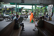 Mar 22, 2009 -- A Buddhist monk walks through the Wong Wian Yai train station in Thonburi. The Mahachai Rail Line is a commuter line that runs from the Wong Wian Yai train station in the Thonburi section of Bangkok to the fishing port and market town of Samut Sakhon, which used to be known as Mahachai. A second line from Baan Laem to Samut Songkhram, another fishing port south of Samut Sakhon. Each stretch of the line takes about an hour.    Photo by Jack Kurtz
