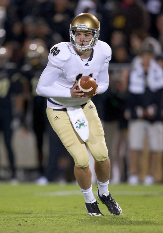 October 01, 2011:  Notre Dame quarterback Tommy Rees (#11) pivots for the handoff during NCAA Football game action between the Notre Dame Fighting Irish and the Purdue Boilermakers at Ross-Ade Stadium in West Lafayette, Indiana.  Notre Dame defeated Purdue 38-10.