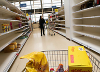 Shelves at Tescos Bicester have been emptied again as people continue to stockpile food and cleaning supplys during the coronavirus outbreak photo Brian Jordan