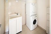 Laundry room with modern washer and dryer, nobody inside