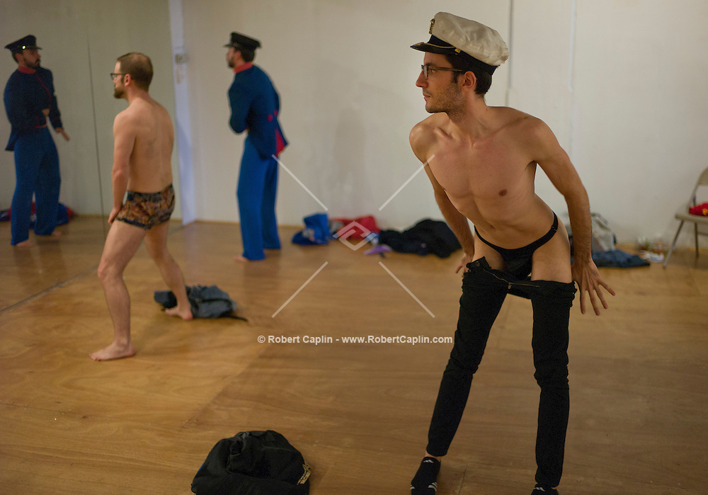 """Johnny Panic works on a striptease during a """"Boylesque"""" Class, Burlesque dancing for men, at Triskelion Arts Center in Williamsburg, Brooklyn...Photo © Robert Caplin.."""