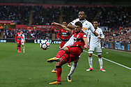 Tommy Smith of Huddersfield Town holds off Jordan Ayew of Swansea city ®. Premier league match, Swansea city v Huddersfield Town at the Liberty Stadium in Swansea, South Wales on Saturday 14th October 2017.<br /> pic by  Andrew Orchard, Andrew Orchard sports photography.