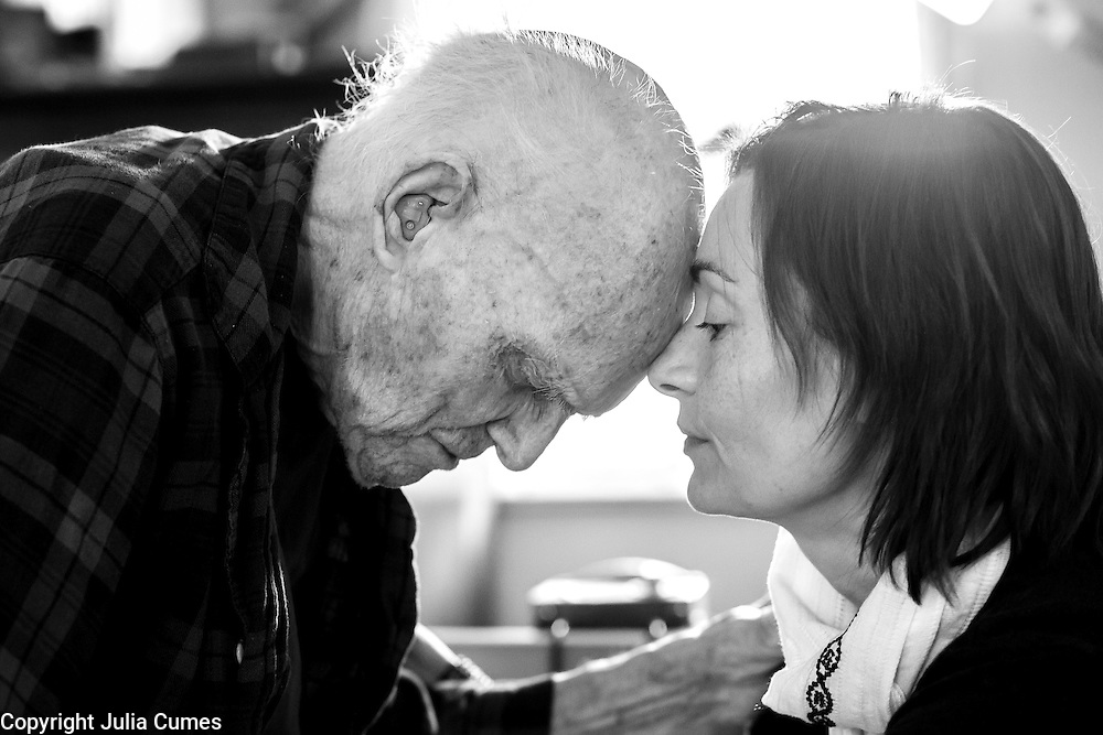 """I photographed Reverend Gerald Gilmore, 100, and his granddaughter, Nina Gilmore,at his home in Orleans. Nina had come to Cape Cod to spend the last few months with her grandfather. I was so moved by the connection between Nina and her grandfather who, she said, was like a father to her. """"He was filled with adventure, whimsy and light,"""" she told me. I thought this moment captured the bond between them. A few days after this photo was taken, Reverend Gilmore passed away."""
