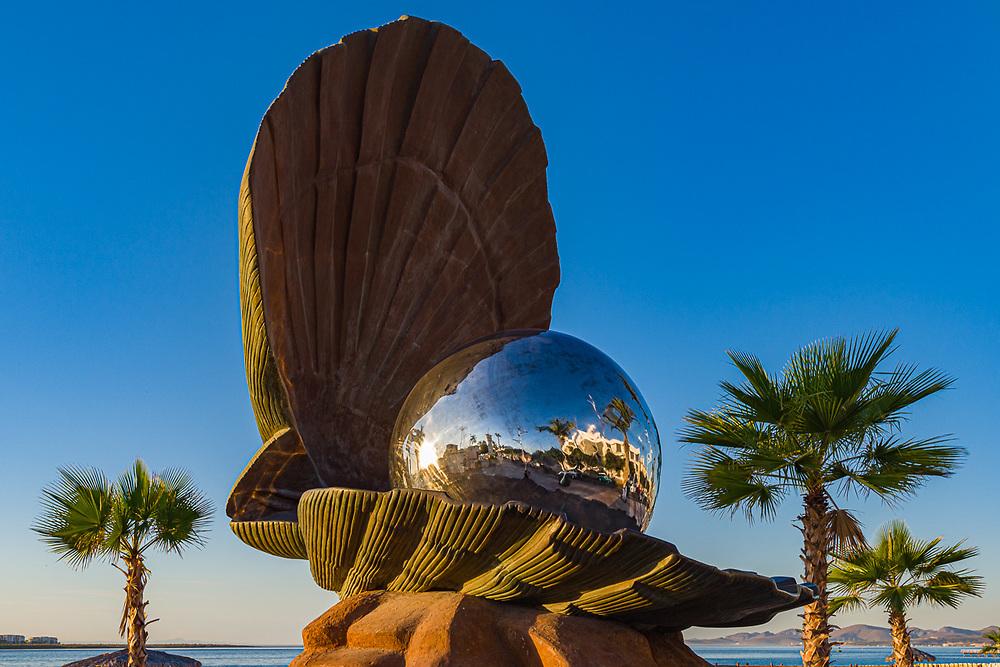 Pearl sculpture on the Malecon, evening light, February, La Paz, Baja, Mexico