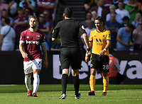 Football - 2018 / 2019 Premier League - West Ham United vs. Wolverhampton Wanderers<br /> <br /> West Ham United's Jack Wilshere remonstrates with Referee Chris Kavanagh, at The London Stadium.<br /> <br /> COLORSPORT/ASHLEY WESTERN