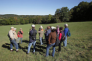 Salisbury Mills, New York - Hudson Highland Nature Museum board member George Muser, left, and naturalist Bob Kakerbeck of West Point's Natural Resources Branch talk to a group of people during a hike through Clove Brook Farm at the base of Schunnemunk Mountain on Oct. 2, 2010. The outing was organized by the Hudson Highlands Nature Museum.