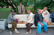 Saint Petersburg, Russia, August 2002..Unemployed and homeless men play chess in a city centre park. Fyodor Dostoyevsky,  chronicler of Russia's under class, would still recognise much in his native city. The streets he knew still teem with thieves, drunks, homeless & those on the fringes of society..