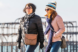 © Licensed to London News Pictures. 02/02/2019. Brighton, UK. Members of the public enjoy a Saturday morning walk in the sunshine on the Brighton and Hove promenade. Photo credit: Hugo Michiels/LNP