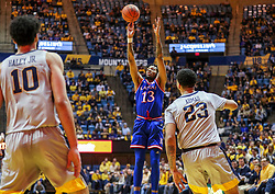 Jan 19, 2019; Morgantown, WV, USA; Kansas Jayhawks guard K.J. Lawson (13) shoots during the first half against the West Virginia Mountaineers at WVU Coliseum. Mandatory Credit: Ben Queen-USA TODAY Sports